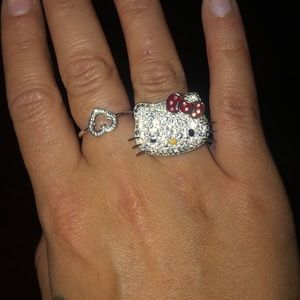 Oversized hello kitty ring with red bow.